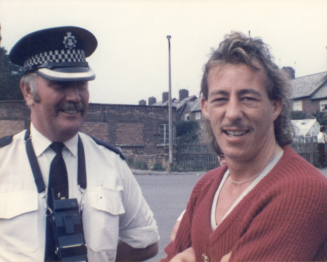 Cresswell Colliery on a quiet day. Bob Wilson has a laugh and a joke with a friendly commanding police officer, at the entrance to the pit.