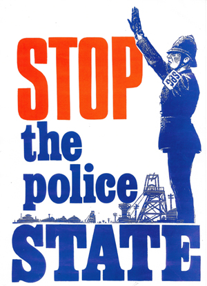 "A ""POLICE STATE"" POSTER WE HAD STUCK ON MY CAR REAR WINDOW DRIVING BACK UP THE M1 MOTORWAY."