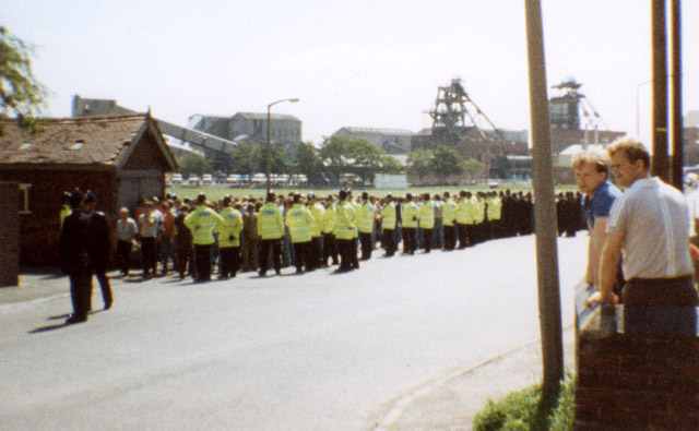 Cresswell Colliery. June 1984. Police in High visibility jackets were the 'snatch squad' and they were big buggers. Any trouble, even a shout they would reach into the pickets and 'snatch' you.