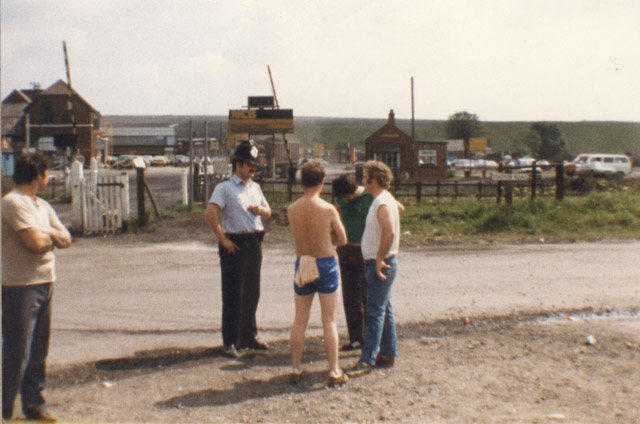 Newstead Colliery. Pickets telling a policeman the joke about a picket telling a Policeman a joke. He didn't find it funny, so he arrested him!
