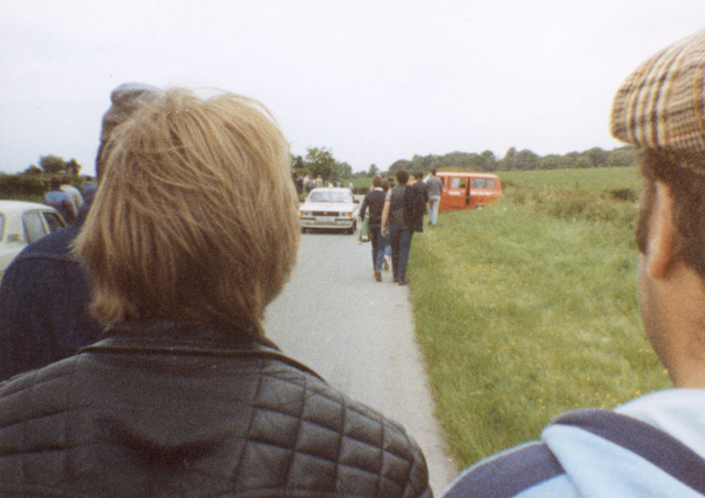 Walking to the picket line, Harworth Colliery. (Left) Shaun, (right) Captain Bob with flat cap on. The vans and cars parked up belong to flying pickets.