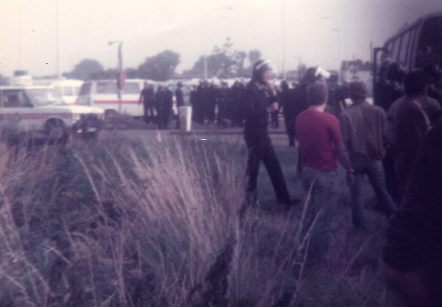 Heading for Gunness Wharfe, Scunthorpe. Police go to their vans and swap their 'Noddy hats' for riot helmets.