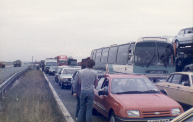 Pickets having a discussion and a game of football on the M180. The coach of old ladies can be seen behind the cars at the front.