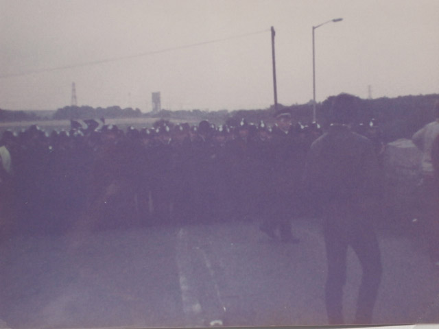 Police blocking the road to Harworth Colliery Notts. Maltby pit in the distance.