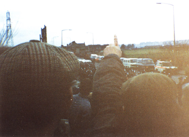 Cortonwood Colliery 'The Alamo' January 1985. Striking Miners' heckle police reinforcements being marched up to the front line. When it goes dark, They are replaced by riot police.