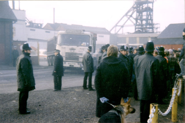A convoy of lorries leave Silverwood Colliery loaded with coal.