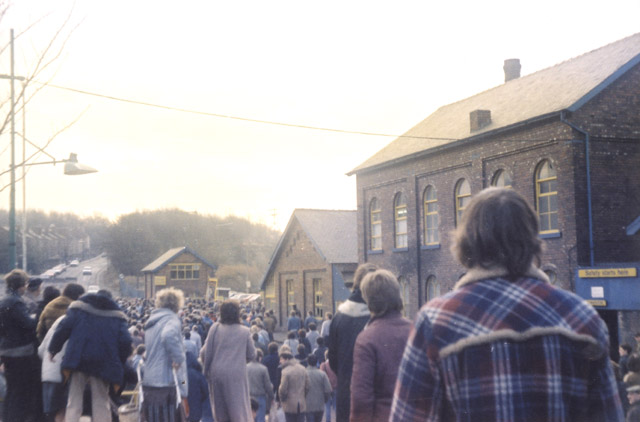 The March back to work, Silverwood colliery. Approaching the pit gates. The pit banner can be seen bottom left of the photo. Miners, their wives, families and supporters all marched.