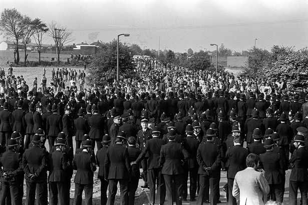 Confrontation: Police greet pickets as they arrive on the hill heading to the Orgreave plant PA
