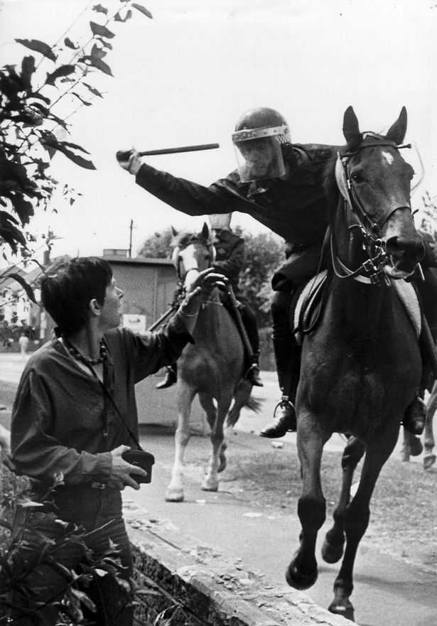 Leslie Bolton from 'Women Against Pit Closures' defends herself as Police mounted on horseback attack, Sheffield, John Harris